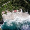 aerial drone photography bali padang bai village white sand bias tugel beach waves from the top