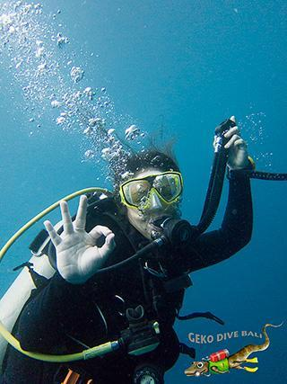 Scuba Diver Underwater Tulamben Bali Indonesia Ok Sign Blue Water Deflate Bcd Vertical 320px